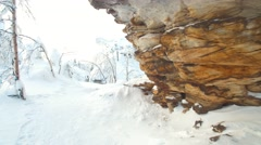 Explore the snow covered trails among the layered rocks on a sunny day Stock Footage