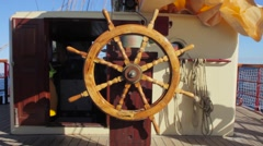 The helm of a tall ship lies empty whilst sailing at sea. Stock Footage