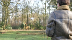 Over shoulder shots of operating a drone, 4K UltraHD Stock Footage
