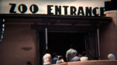 1972: Retro zoo entrance sign attracts animal loving visitors. Stock Footage