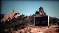 1972: Garden of the Gods park entrance sign on bright blue day. Stock Footage