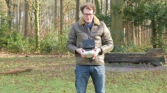 A man is operating a drone straight to the camera, 4K UltraHD Stock Footage