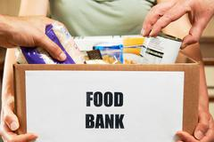 Making Donations To Food Bank - stock photo