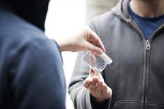 Man Buying Drugs On The Street - stock photo