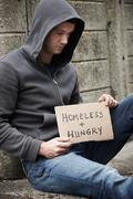 Homeless Young Man Begging On The Street - stock photo
