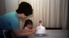 1974: Mother daughter sharing princess cake making moment together. Stock Footage
