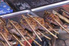 Grilled fish on a vegetable and food market Stock Photos