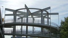 Cyclists riding up a spiral ramp to access a bridge across the Danube, Vienna Stock Footage