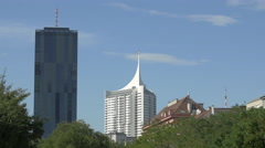 DC Tower 1 and other buildings in Donau City, Vienna Stock Footage