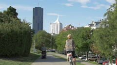 Walking and riding bikes in Donau City, Vienna Stock Footage