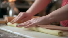 Woman rolling raw cinnamon buns. Stock Footage