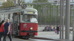 Walking next to the tram no.0 at Praterstern light rail station in Vienna Stock Footage