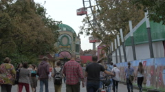 Walking on an alley near the Giant Ferris Wheel in Prater, Vienna Stock Footage
