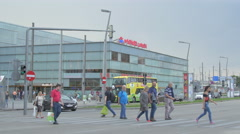 People walking and driving cars next to the Praterstern metro station in Vienna Stock Footage
