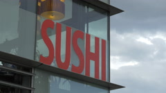 Ginza Running Sushi sign on a modern building in Vienna Stock Footage