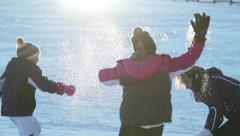 Slow motion kids and mom during snowball fight Arkistovideo