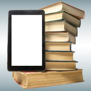 Stack of colorful books and electronic book reader. Electronic library concept Stock Photos