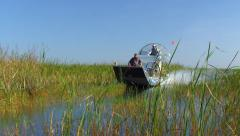 Airboat Speeding by in Florida Everglades Stock Footage