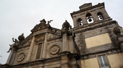 Low angle of Church of Our Lady of Graça, bells and statues, Evora, Portugal Stock Footage