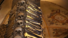 Chapel of Bones pillar, skeletons, skulls, church, shallow DOF, Evora, Portugal Stock Footage