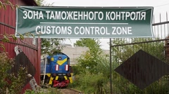 Green customs control zone signboard. Abandoned railway carirage on a background - stock footage