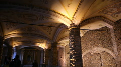 Chapel of Bones ceiling pillar, skeletons, skulls, scary church, pan left Stock Footage