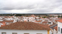 Town of Evora orange rooftops, Portugal countryside, pan left Stock Footage
