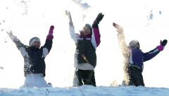 Children playing with snow slow motion Stock Footage