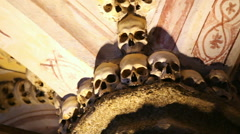 Chapel of Bones ceiling pillar, skeletons, skulls, scary church, Evora, Portugal Stock Footage