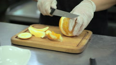Cook cleans orange Stock Footage