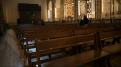 Empty church cathedral benches, tilt up to high ceiling window, Portugal Stock Footage
