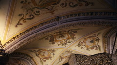 Chapel of Bones ceiling, skeletons, skulls, church, long shot, pan left Stock Footage