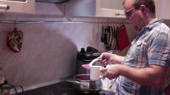 Man pours a ladle juice - stock footage