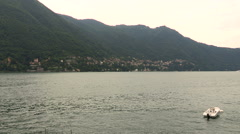 A motorboat anchored near the shores of Lake Como Stock Footage