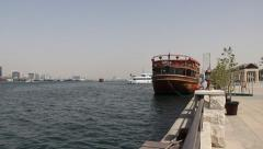 Wood boat restaurant against Dubai Creek embankment. daytime Stock Footage