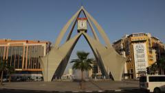 Deira Clocktower in evening sunlight, roundabout traffic move Stock Footage
