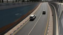 Small number of cars ride at Baniyas Road underpass exit Stock Footage