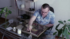 Man covered with lacquer painting Stock Footage