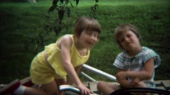1973: Cute twin girls smiling at summer family reunion outdoor event. Stock Footage