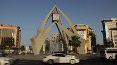 Busy traffic at Dubai Clock Tower Roundabout, evening time, low sun light Stock Footage