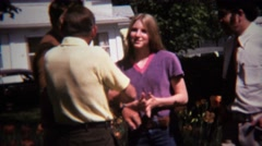 1973: Hot teenage girl surrounded by creepy uncles at family reunion. Stock Footage