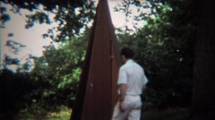 1973: A-frame construction style outdoor outhouse bathroom toilet. - stock footage