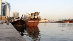 Cargo dhow stay at pier, loaders work with goods, general view Stock Footage