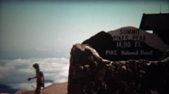 1972: Pikes Peak Summit sign and people walking past. Stock Footage