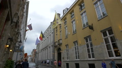 People  on Hoogstraat near Hotel Malleberg and Grand Hotel Casselbergh in Bruges Stock Footage