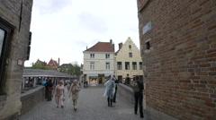 Marketplace in Steenhouwersdijk street seen from Blinde - Ezelstraat Bruges Stock Footage