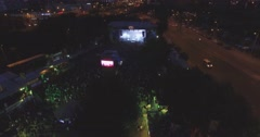 Flying over a huge concert crowd in the Budapest Park Stock Footage