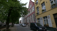 Beautiful houses on  Steenhouwersdijk street near Dijver Canal in Bruges Stock Footage