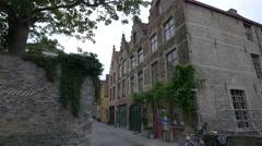 View of Die Swaene Hotel and old buildings on Meestraat street in Bruges Stock Footage