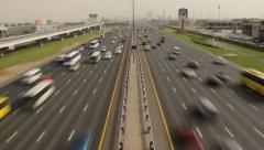 Continuous traffic along E 11 highway, Sheikh Zayed road time lapse shot Stock Footage